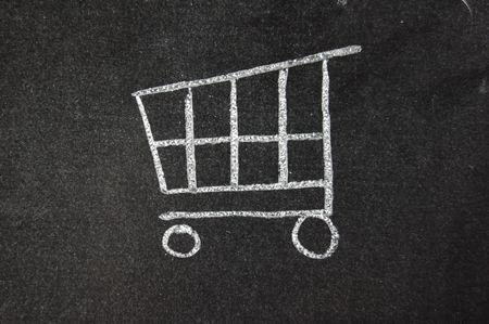 checkout: E-commerce trolley symbol drawn on a blackboard Stock Photo