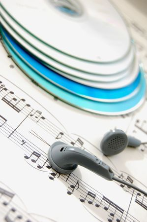 music score: Pair of headphones on a music score  Stock Photo