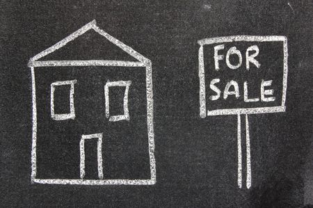 Child like drawing of a house for sale on a blackboard photo