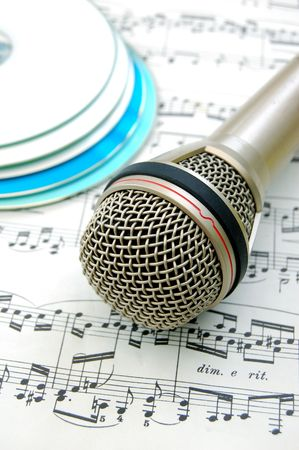 cds: Microphone with music sheet and several cds Stock Photo