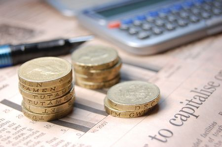 pound coins: British pound coins next to the word capitalise