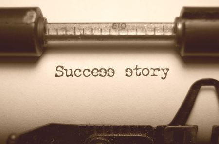 Success story typed on an old typewriter photo