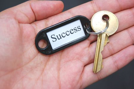 Holding the key to success photo