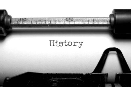 History writte on an old typewriter Stock Photo