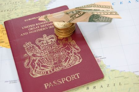 British passport on a map with a dollar paper airplane Stock Photo - 6570650