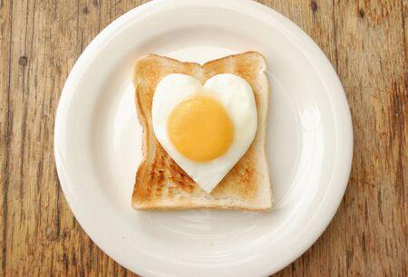 Heart shaped egg on toast photo
