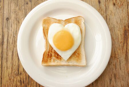 shaped: Heart shaped egg on toast Stock Photo