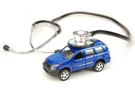 examine: Stethoscope and toy car Stock Photo