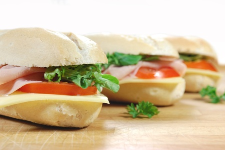 Sub sandwich baguettes with ham and cheese photo