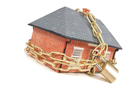 repossessed: House tied with a gold chain and padlock