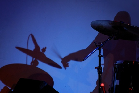 Shadow of a drummer performing on stage