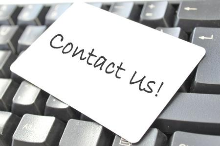 Póngase en contacto con nosotros  Foto de archivo