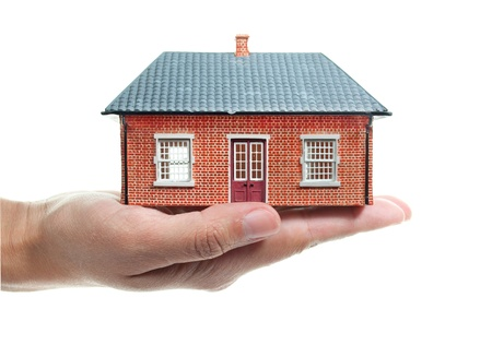 Hand holding a small house Stock Photo - 10859853