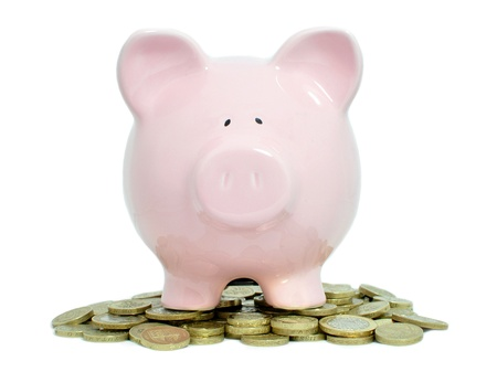 british money: Piggybank and coins