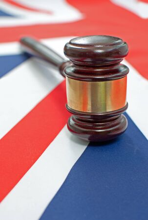 court proceedings: Gavel on top of a british flag