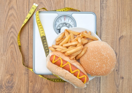 bad diet: Weighing scales bad diet  Stock Photo