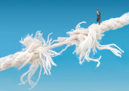 Businessman on breaking tightrope Stock Photo - 13473179