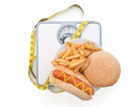 Bad diet on weighing scales  Stock Photo - 13473210
