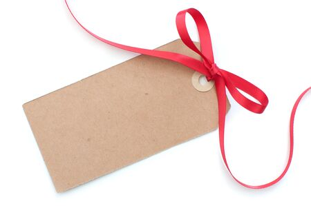 Blank gift tag with a red satin ribbon bow Stock Photo - 16492225