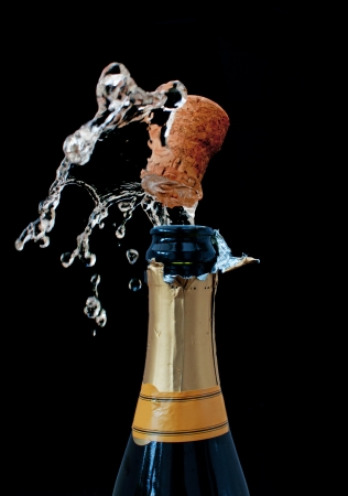 champagne bottle: Champagne uncorked Stock Photo
