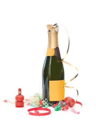 party poppers: Champagne bottle surrounded by party poppers and streamers