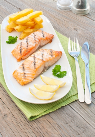 Grilled salmon fillets with chips  photo