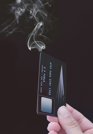 credit crisis: Credit card on fire