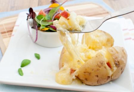 oven potatoes: Melting cheese baked potato
