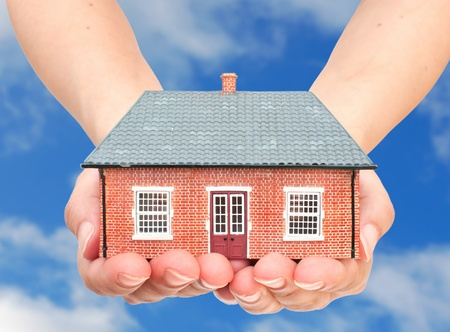 inheritance: Small house in hands