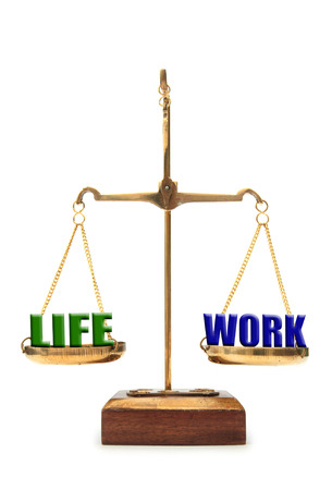 work life balance: Work and balance on weighing scales  Stock Photo