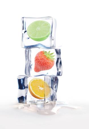 Fresh fruit inside ice cubes  photo