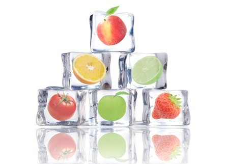frozen fruit: Fruit inside ice cubes  Stock Photo