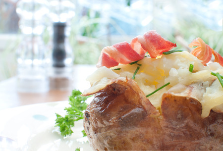spud: Baked jacket potato with bacon and chives