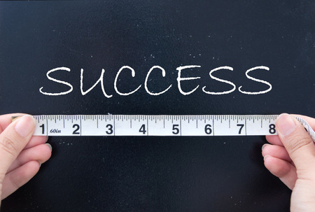 measure tape: Measuring success  Stock Photo