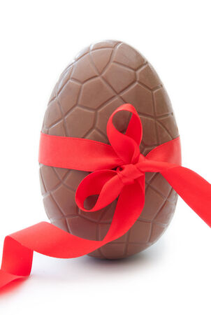 Chocolate easter egg with decorative red ribbon  photo