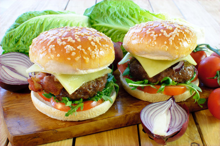Two hamburgers with cheese and tomato filling  Stock Photo