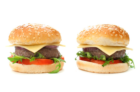 pounder: Quarter pounder cheeseburgers with tomatoes and onions  Stock Photo