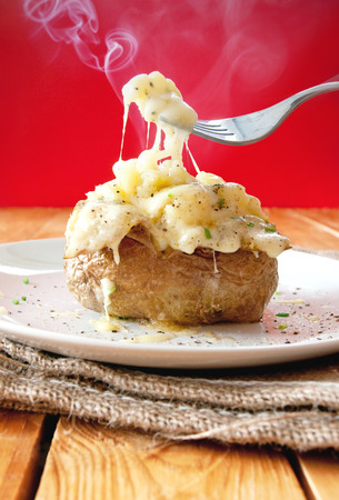 steaming: Hot baked jacket potato with melting cheese