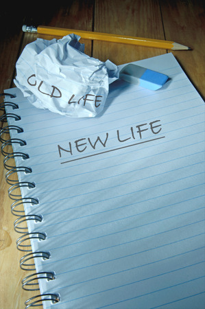 new direction: New life written on note book