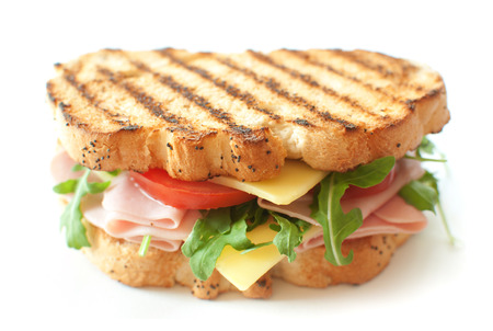 Grilled sandwich with ham and cheese and rocket salad