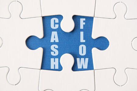 Cash flow jigsaw solution photo