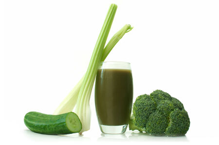 Green smoothie with fresh vegetables over a white background photo