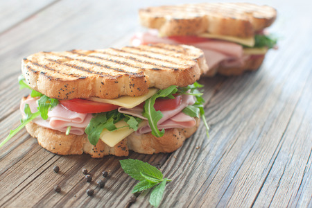 Grilled deli sandwiches with ham and cheese