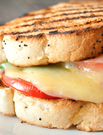 melted cheese: Grilled sandwich with ham and melted cheese