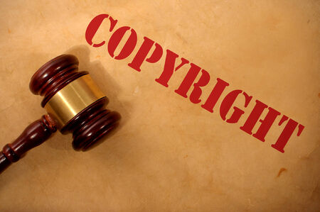 plagiarism: Copyright text heading and gavel Stock Photo