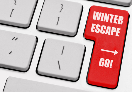 escape key: Winter escape printed on a computer return key Stock Photo