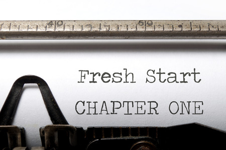 Fresh start chapter one printed on an old typewriter photo