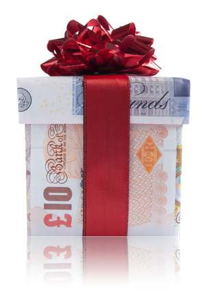british money: Gift box wrapped with sterling pound banknotes with  red silk ribbon Stock Photo