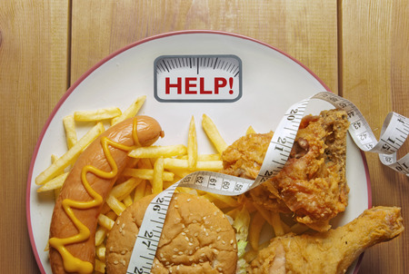 unhealthy diet: Diet weighing scales concept Stock Photo
