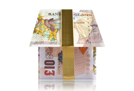british money: Money house made from British banknotes with gold ribbon Stock Photo